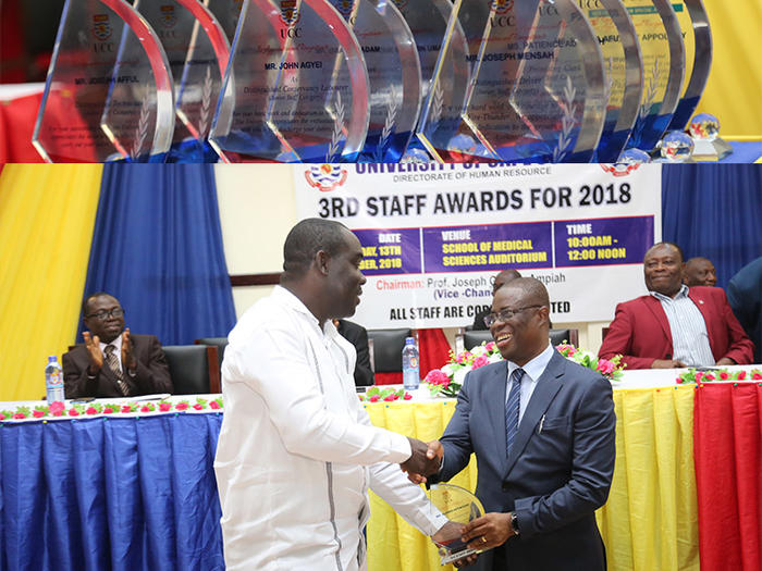 The Vice-Chancellor, Prof. Joseph Ghartey Ampiah presenting an award to a deserving staff