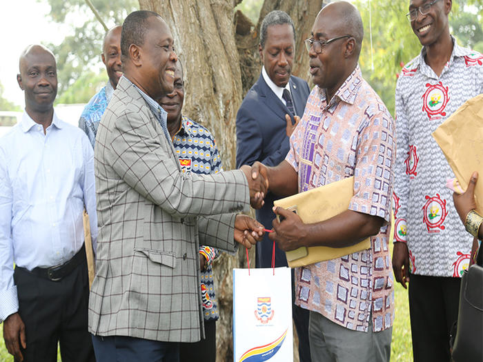 Prof. Oduro presenting UCC branded souvenir to the leader of the Ghana Medical and Dental Council delegation